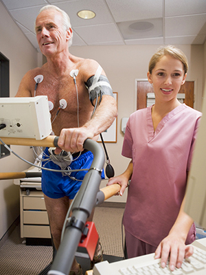 Man on treadmill with EKG leads
