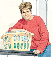 Woman leaning over laundry basket, looking distressed.