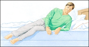 Image of man pushing his upper body off the bed