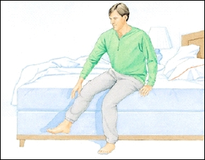 Image of man leaning forward in bed and pushing himself up with his arms