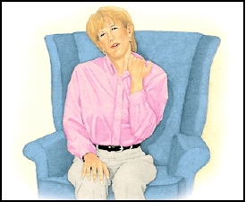 Woman sitting in comfortable chair rubbing neck.